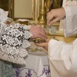 Stock Photo: Hands of priest by mass
