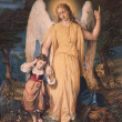 SLOVAKIA - DECEMBER 4: Guardian angel with the child. Typical catholic print image from the beginning of the 20th. century in parish building of Marianka on December 4, 2012 in Slovakia. - Stock Photo