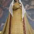 BRUSSELS - JUNE 21: Virgin Mary statue in the needlework garments from side altar at st. Nicholas church on June 21, 2012 in Brussels. - Stok fotoğraf