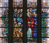 BRUSSELS - JUNE 22:Jesus give Peter the Keys to the Kingdom from windowpane of National Basilica of the Sacred Heart built between years 1919 - 1969 on June 22, 2012 in Brussels. — Stock Photo