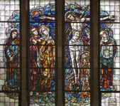 BRUSSELS - JUNE 22: Crucifixion scene. Detail from windowpane of National Basilica of the Sacred Heart built between years 1919 - 1969 on June 22, 2012 in Brussels. — Stock Photo