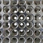 Holes - chrome background — Stock Photo
