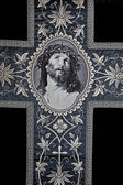 Jesus Christ face on the catholic funeral vestment — Stock Photo