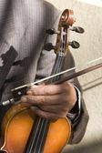 Hand of old fiddle — Stock Photo