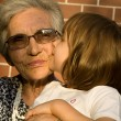 Royalty-Free Stock Photo: Grandmother and grandchild in evening light