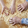 Hands of grandmother and grandchilds at cooking — Stok fotoğraf
