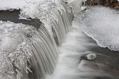 Little waterfall and icicle from winter creek — Stock Photo