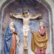 Christ on the cross from Mariazell cross way - ceramic - Stock Photo