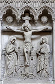 BRUSSELS - JUNE 22: Relief of Crucifixion from Saint Michael and Saint Gulda catehedral in June 22, 2012 in Brussels. — Stock Photo