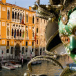 Venice - mask and canal grande in evening - Stock Photo