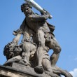 Statue on the portal from castle in prague - Hercules - Stock Photo