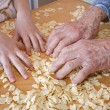 Hands of grandmother and grandchild at cooking - Stock Photo