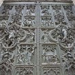 Milan - detail from main bronze gate of Duomo cathedral - Stock Photo