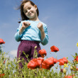 Little girl and corn roses - Stock Photo