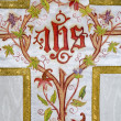Stock Photo: Cross - detail of painted catholic vestment