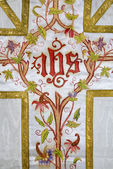 Cross - detail of painted catholic vestment — Stock Photo