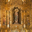 MADRID - MARCH 10: Madonna and baroque altar of Capilla del Sanctisimo from church San Isidoro on March 10, 2013 in Madrid. — Stock Photo
