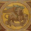 MADRID - MARCH 9: Mosaic of bull as symbol of Saint Luke the Evangelist in Iglesia de San Manuel y San Benito by architect Fernando Arbos from 19. cent. in March 9, 2013 in Madrid. — Foto de Stock