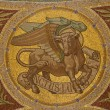 MADRID - MARCH 9: Mosaic of bull as symbol of Saint Luke the Evangelist in Iglesia de San Manuel y San Benito by architect Fernando Arbos from 19. cent. in March 9, 2013 in Madrid. — Photo