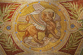 MADRID - MARCH 9: Mosaic of lion as symbol of Saint Mark the Evangelist in Iglesia de San Manuel y San Benito by architect Fernando Arbos from 19. cent. in March 9, 2013 in Madrid. — Stock Photo