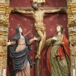 TOLEDO - MARCH 8: Crucifixion baroque statue with hl. Mary and saint John from church Iglesia de san Idefonso on March 8, 2013 in Toledo, Spain. — Stock Photo
