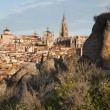 Toledo - Cathedral and Jesuits and other churches and old town in morning light and the rocks — Stock Photo