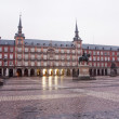 Постер, плакат: MADRID MARCH 9: Plaza Mayor in morning dusk with the statue of Philips III and Casa de la Panaderia in March 9 2013 in Spain