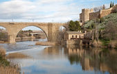 Toledo - San Martin s bride or Puente de san Maritn in morning light — Stock Photo