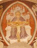 VERONA - JANUARY 28: Fresco of holy Trinity from main apse of Chiesa di Santissima Trinita consecrated in 1117 on January 28, 2013 in Verona, Italy. — Stock Photo