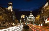 Madrid - look from Plaza de Cibeles in dusk to Cale de Alcala street and Metropolis building — Stock Photo