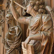 MECHELEN, BELGIUM - SEPTEMBER 4: Carved Apocalyptic angel with the  trumpet from Onze-Lieve-Vrouw-van-Hanswijkbasiliek church on Sepetember 4, 2013 in Mechelen, Belgium. — Stock Photo