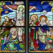 MECHELEN, BELGIUM - SEPTEMBER 6: Crucifixion scene from windowpane of St. Rumbold's cathedral on Sepetember 6, 2013 in Mechelen, Belgium. — Stock Photo