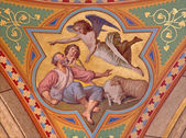 VIENNA - JULY 27: Fresco of revelation of angels to shepherds scene in side nave of Altlerchenfelder church from 19. cent. on July 27, 2013 Vienna. — Stock Photo