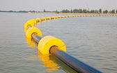 Pipes and buoys on the water table — Stock Photo