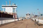 ANTWERP, BELGIUM - SEPTEMBER 5: Promenade and big cargo boat on September 5, 2013 in Antwerp, Belgium — Stock Photo