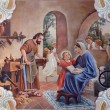 SEBECHLEBY - AUGUS 8: Holy Family. Fresco from year 1963 by Jozef Antal in st. Michael parish church on August 8, 2013 in Sebechleby, Slovakia. — Stockfoto #31674513