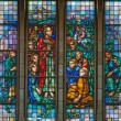 BRUSSELS - JUNE 22: Learning of Jesus from windowpane of National Basilica of the Sacred Heart built between years 1919 - 1969 on June 22, 2012 in Brussels. — Stock Photo