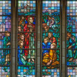 BRUSSELS - JUNE 22: Learning of Jesus from windowpane of National Basilicof Sacred Heart built between years 1919 - 1969 on June 22, 2012 in Brussels. — Stock Photo #36780743