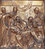 ANTWERP, BELGIUM - SEPTEMBER 5: Metal relief of Pieta from Joriskerk or st. George church as part of cross way cycle on September 5, 2013 in Antwerp, Belgium — Stock Photo