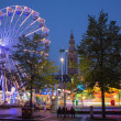LEUVEN - SEPTEMBER 3: Amusement park on Monseigneur Ladeuzeplein - square in evening dusk on September 3, 2013 in Leuven, Belgium. — Stock Photo