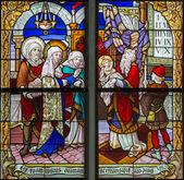MECHELEN, BELGIUM - SEPTEMBER 6: Jesus under cross and his mother from windowpane of St. Rumbold's cathedral on Sepetember 6, 2013 in Mechelen, Belgium. — Stock Photo