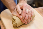 Hands of potter at work — Stock Photo