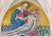VIENNA - JULY 3: Mosaic of pieta from main portal of gothic church Maria am Gestade on July 3, 2013 Vienna. — Stock Photo