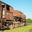 Stock Photo: Old steam locomotive in rust