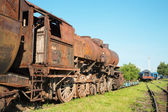 Old steam locomotive in the rust — Stock Photo