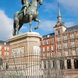 Постер, плакат: Madrid Plaza Mayor in morning light with the statue of Philips III and Casa de la Panaderia in March 9 2013 in Spain