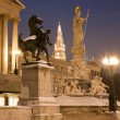 Vienna - Pallas Athena fountain and parliament in winter evening and Town hall tower in background — Stock Photo #37089391