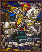 ANTWERP, BELGIUM - SEPTEMBER 5: Windowpane of duel of St. Georeg with the Devil in Joriskerk or st. George church on September 5, 2013 in Antwerp, Belgium — Stock Photo