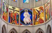 MADRID - MARCH 10: Modern frescos in presbytery from Santa Maria la Real de La Almudena cathedral by Kiko Arguello in March 10, 2013 in Spain. — Stockfoto