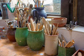 Detail from pottery work room - brushes and tools — Stock Photo